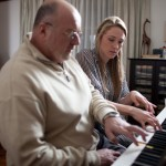 Multitalented producer, Beth, giving a quick piano lesson