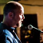 Blurry shot of Eric Dando during our duet reading. Eric's story in this Almanac is 'Space Monkeys Drink Tang'.
